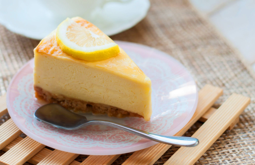 If Decadence Had A Form It Would Look Like The Condensed Milk Baked Lemon Cheesecake Impossibly Sweet No Bake Lemon Cheesecake Lemon Cheesecake Lemon Recipes