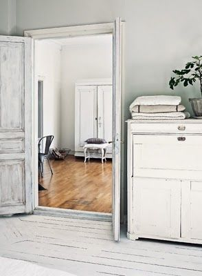 Oooh! White wooden floors and those cabinets! And that door...