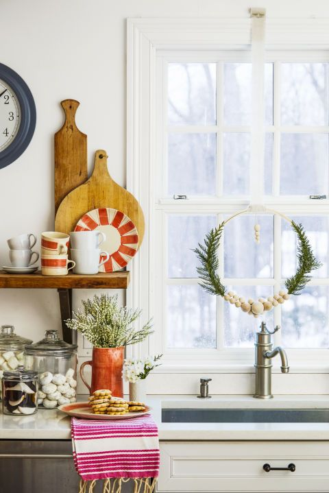 Fancy up your view with a unique wreath made from an embroidery hoop or a garland of lush greenery. What you'll need: embroidery hoop ($9, amazon.com), glue gun ($11, amazon.com)