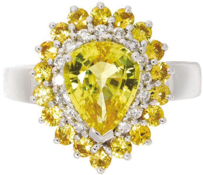 Yellow Sapphire, Diamond, Gold Ring. The ring centers a pear-shapedyellow sapphire measuring 9.00 x 7.50 x 4.50 mm and we...