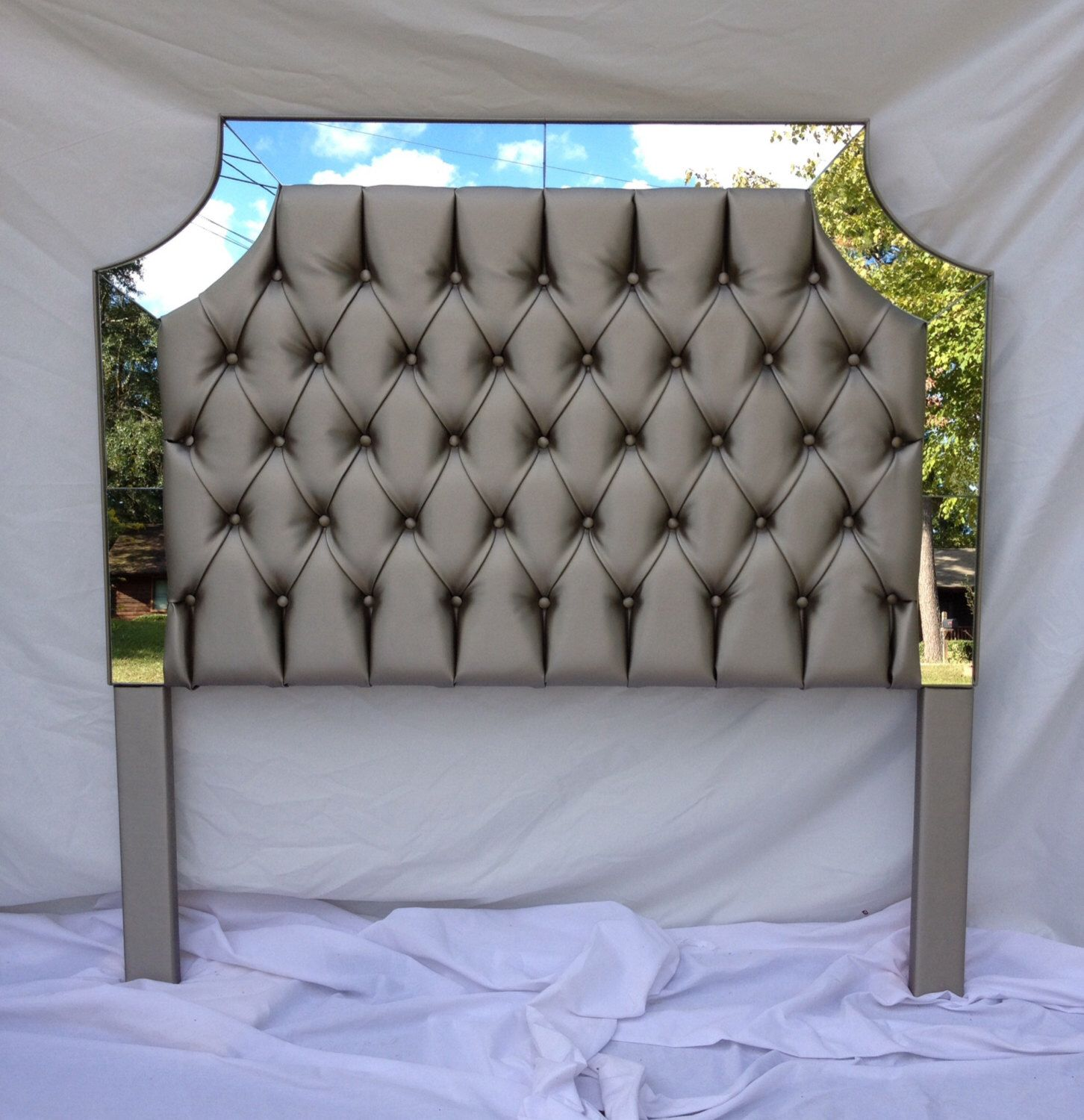 Gray fauxleather upholstered headboard with mirrors tufted