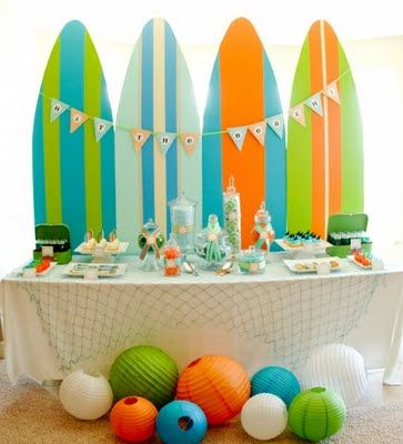 Surf's up party. The surfboards are plywood. I love the lanterns as beach balls.