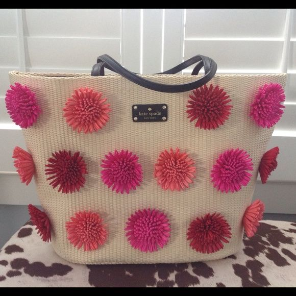 SALE!!! NWT Kate Spade flower embellished tote NWT large raffia look tote with dimensional applied flowers in shades of pink and red. Black leather handles and KS nameplate. Top has snap closure. Inside is a large zipper pocket and wall pockets. SUPER chic and fun bag for Spring and Summer!!! This one is just so darn cute! kate spade Bags
