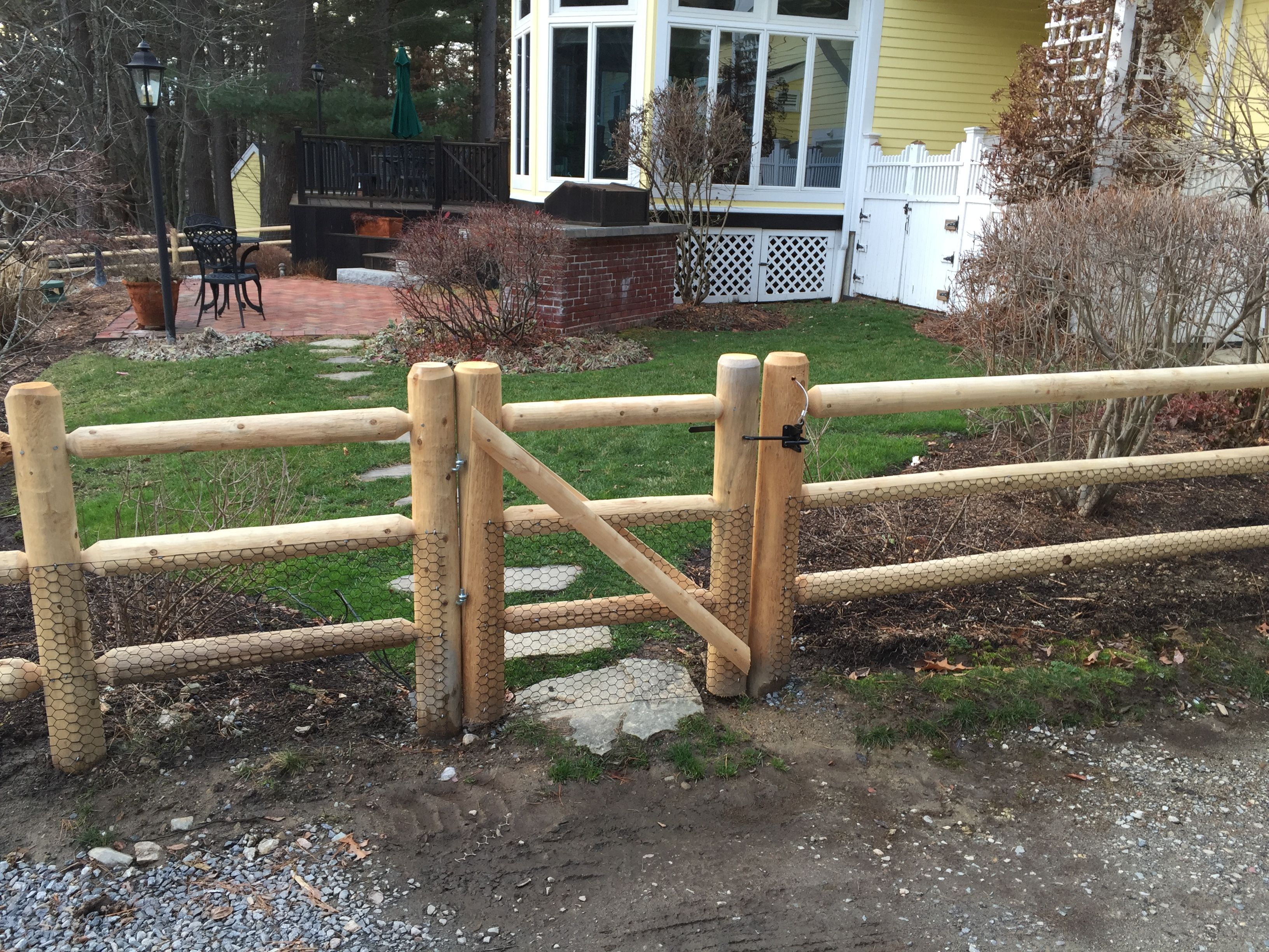 2 rail highlander fence round cedar posts round dowel rails