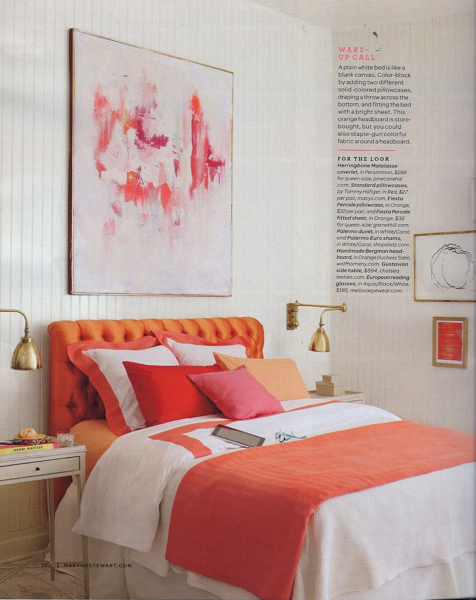 pink and orange and white bedroom. orange tufted headboard