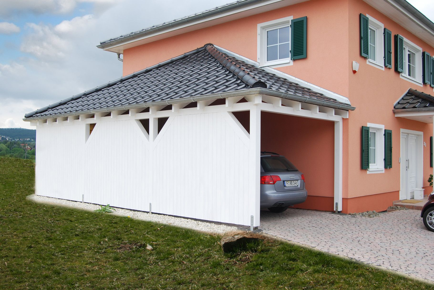 Carport Mit Walmdach Angepasst An Ihr Haus Mit Dachziegeln Regenrinne Und Farbe Finden Sie Inkl Montageservice In Premium Qualitat Hier Walmdach Carport Dach