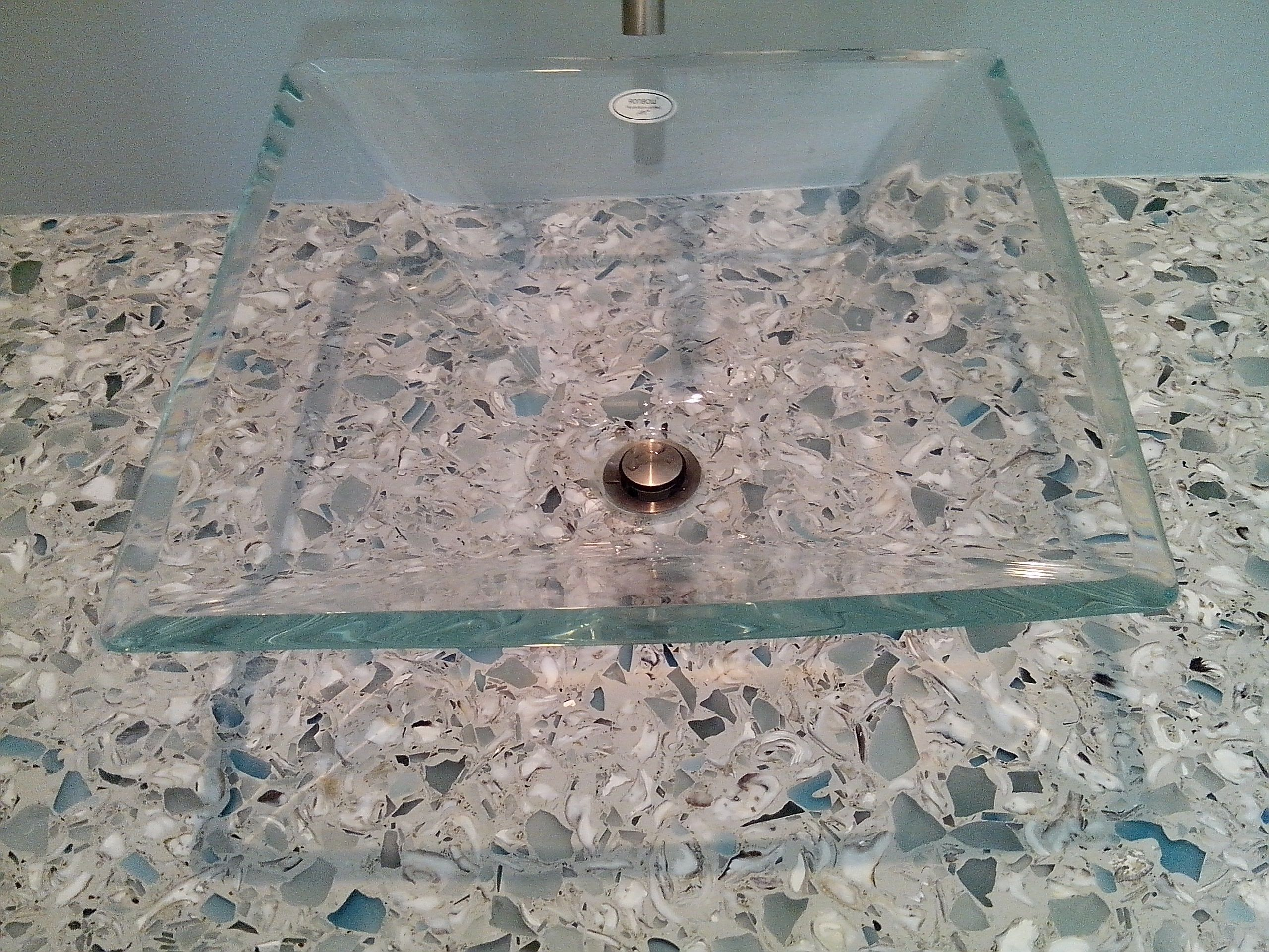 Concrete mixed with oyster shells countertop and a recycled glass ...