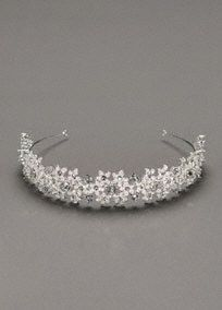 Headband features a floral motif.  Clusters of rhinestones accent metal frame.