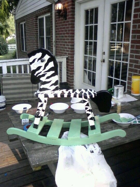 Zebra Rocking horse bought at thrift store,  I handpainted for jungle themed nursery