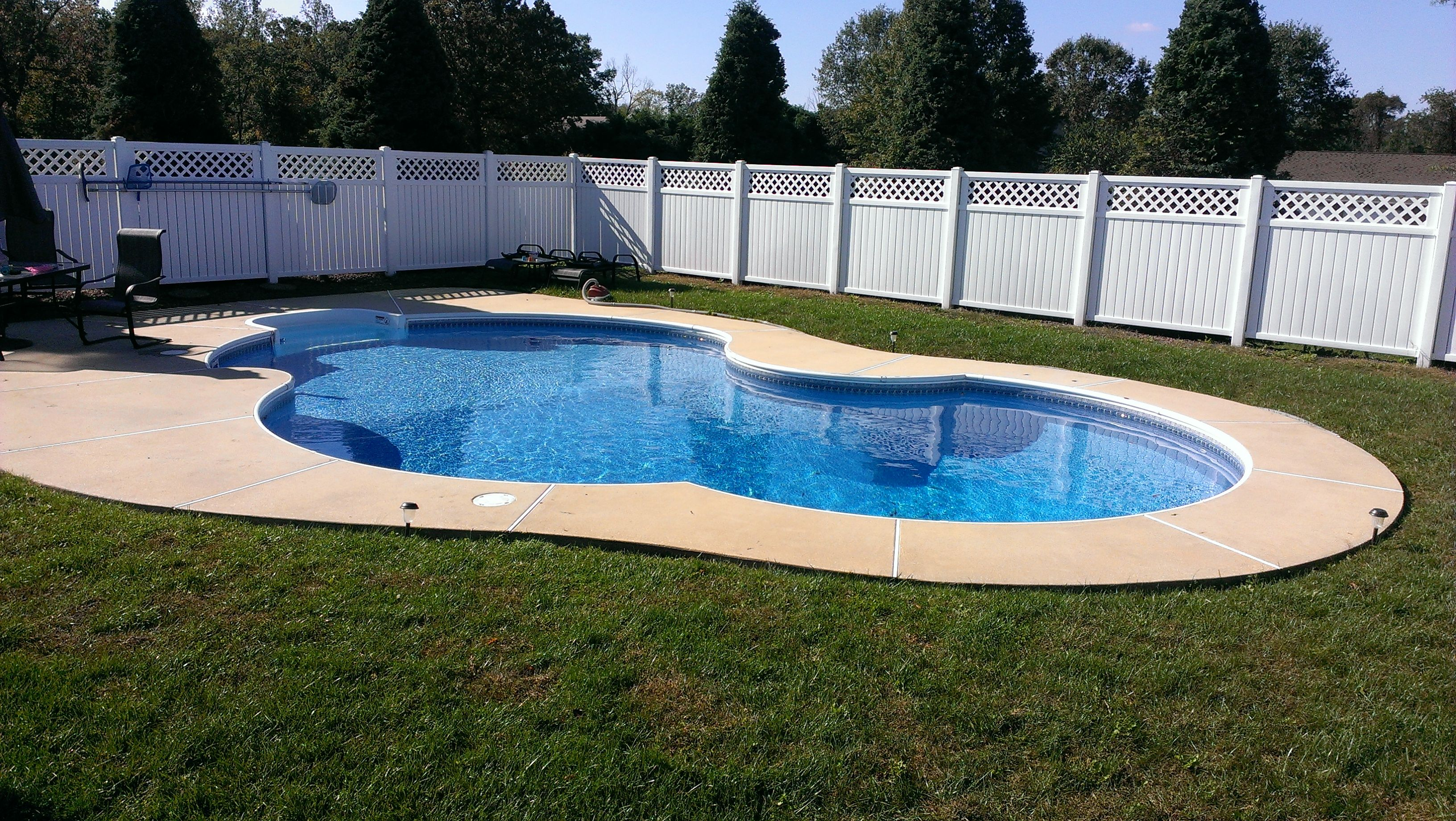 Freeform Swimming Pool Broom Finished Concrete With Privacy Fence Recently Completed