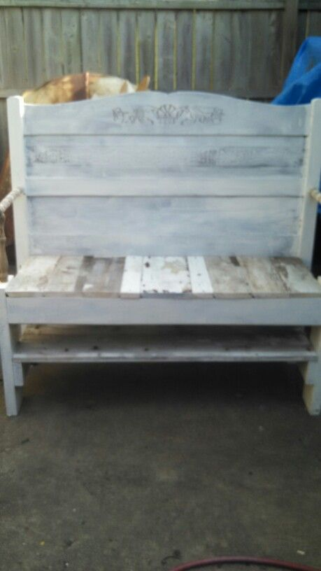 Bench made out of an old discarded headboard and old barn wood.