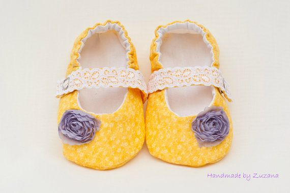Adorable handmade fabric baby shoes in beautiful sunny yellow