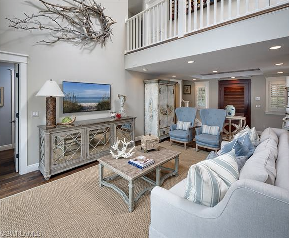 Coastal living room - seagrass rug, driftwood - Beach House with Guest Cottage for Sale in Olde Naples, Florida