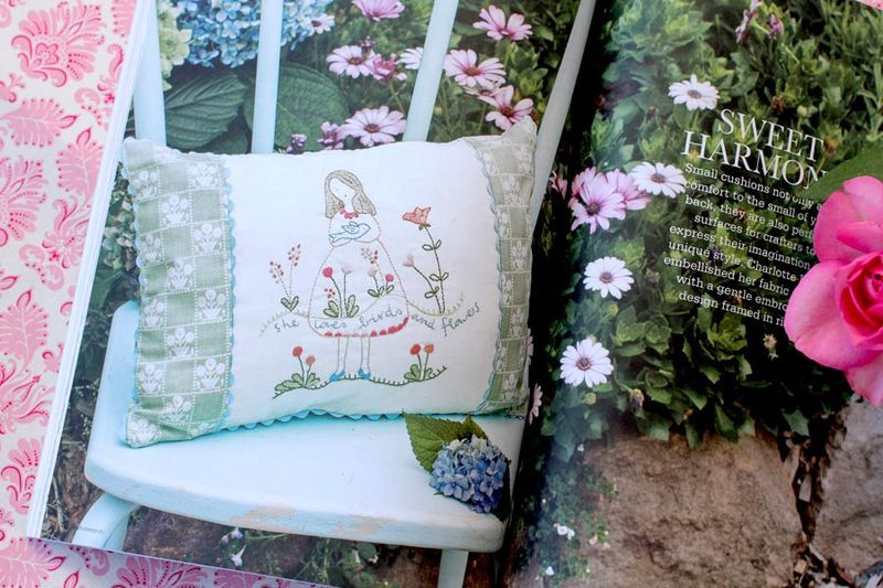 Really cute embroidered cushion.
