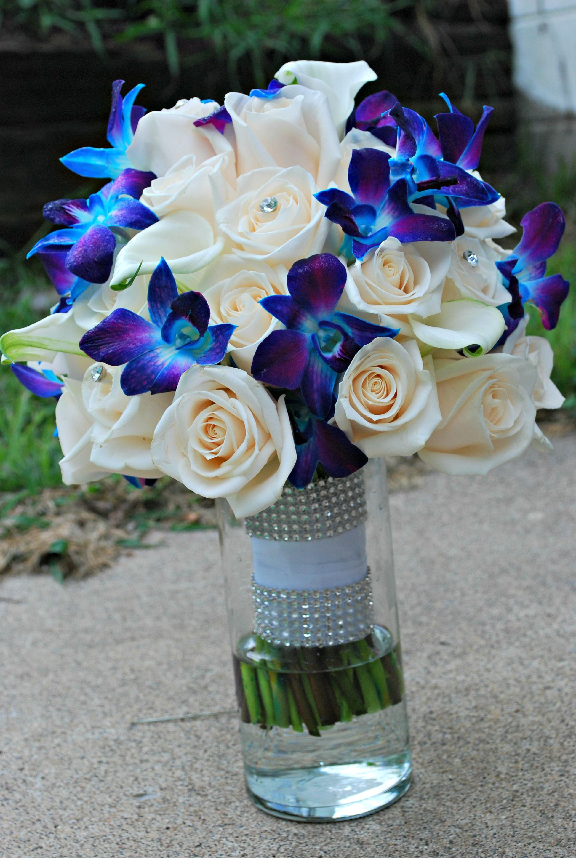 Blue orchid bouquet repined by beneva flowers wedding