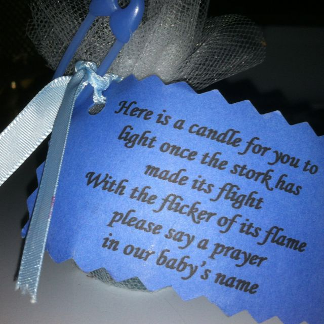 I found this made for my nieces baby shower. A tea light candle (in blue or pink) wrapped in tule, tied with a ribbon, verse and decor.