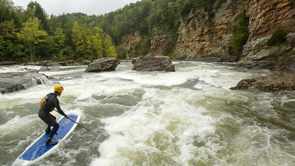 """GAULEY RIVER  FAYETTEVILLE, WEST VIRGINIA  Not for the faint of heart, West Virginia's Gauley River is a Class V rapid-filled rollercoaster ride of fun. When you're not focused on the white water ahead of you, be sure to look up to catch the river's famous rocky """"canyon doors"""" as you paddle past."""