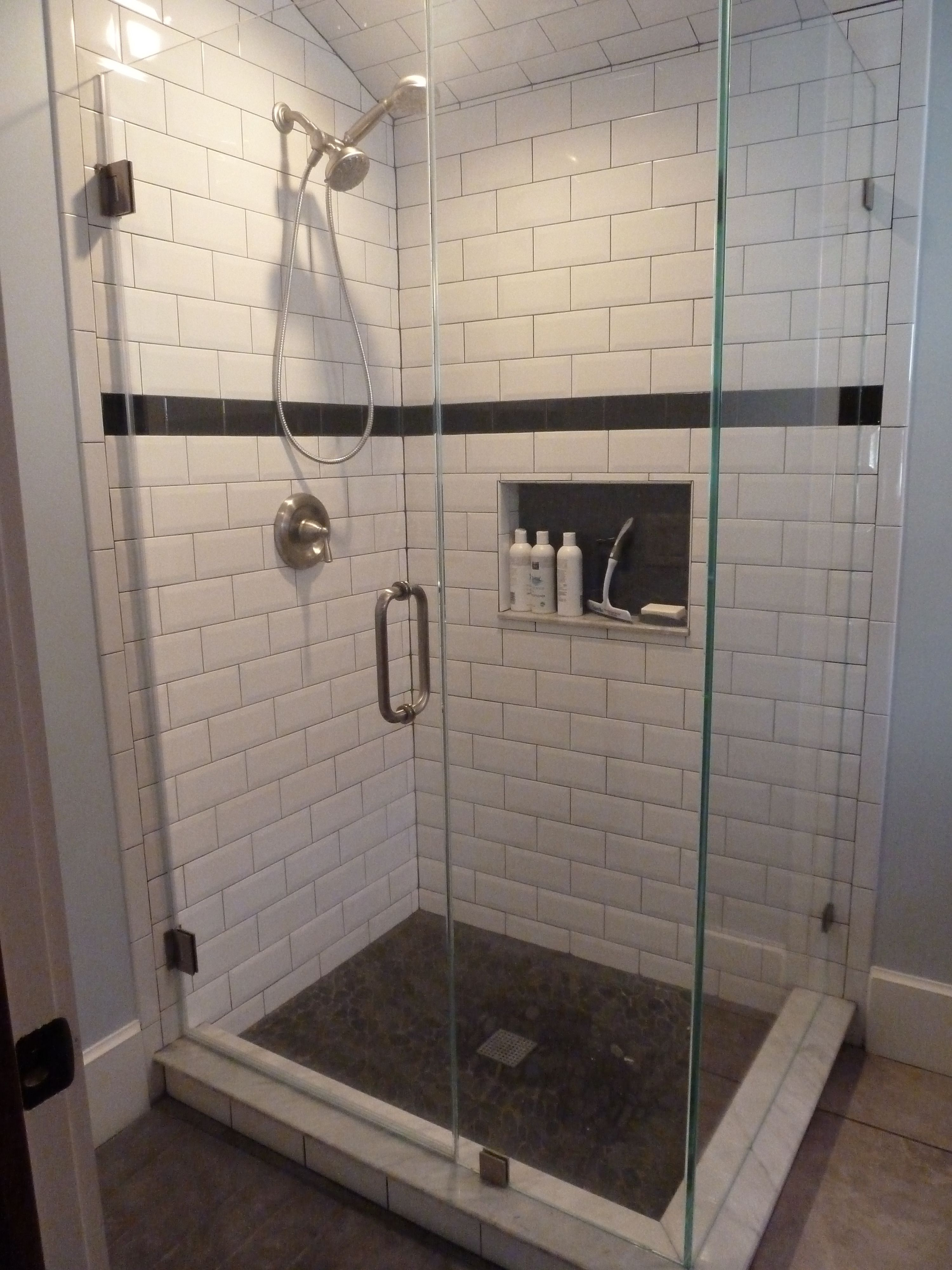 Large Beveled Subway Tile With Smaller Black Subway Tile As Accent Black Grout Black River Stone On Shower F Small Shower Remodel Shower Remodel Shower Tile