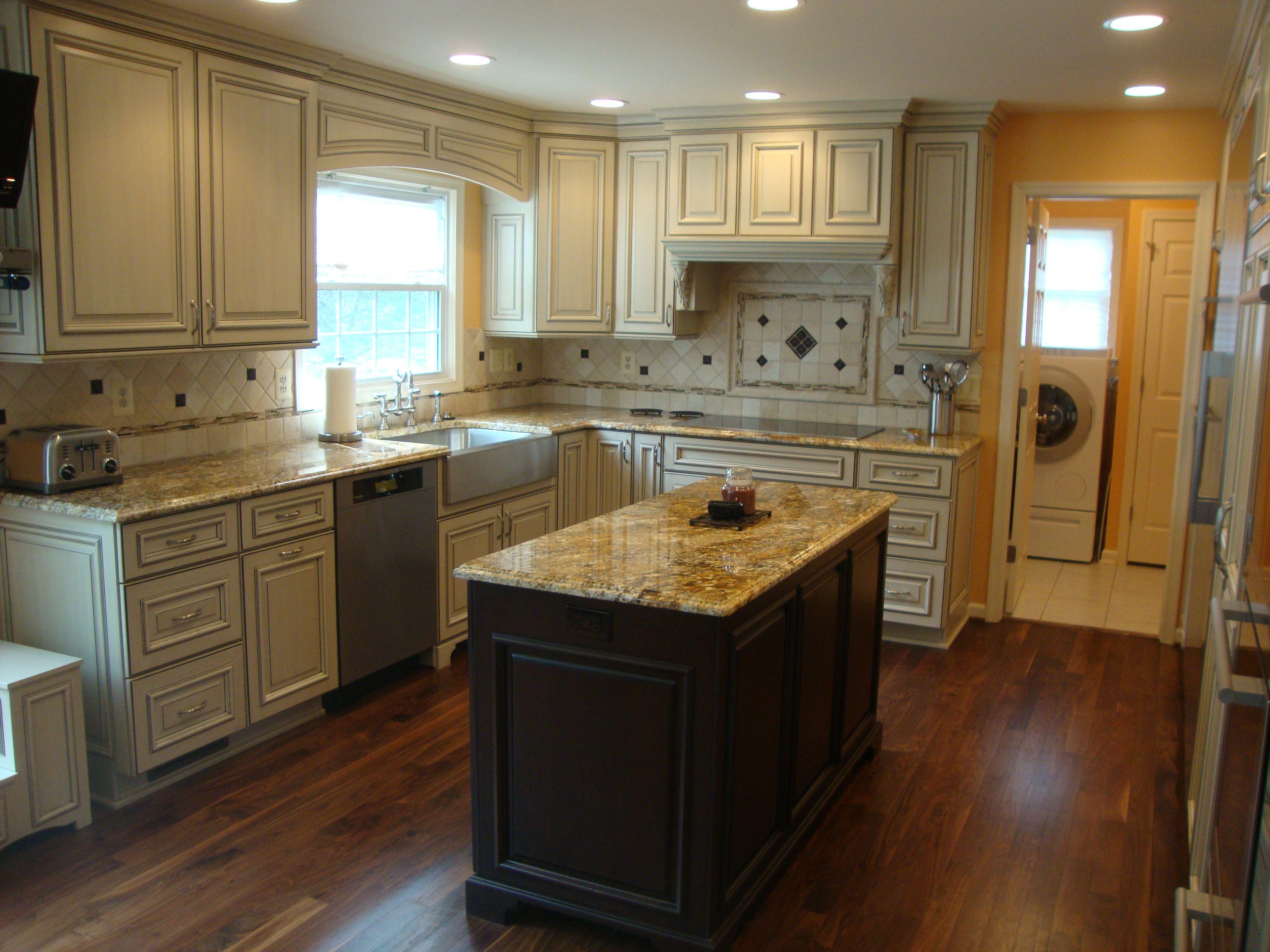White L Shaped Kitchen Design with Black Island Kitchen