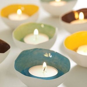 Could put the tea lights into large shells