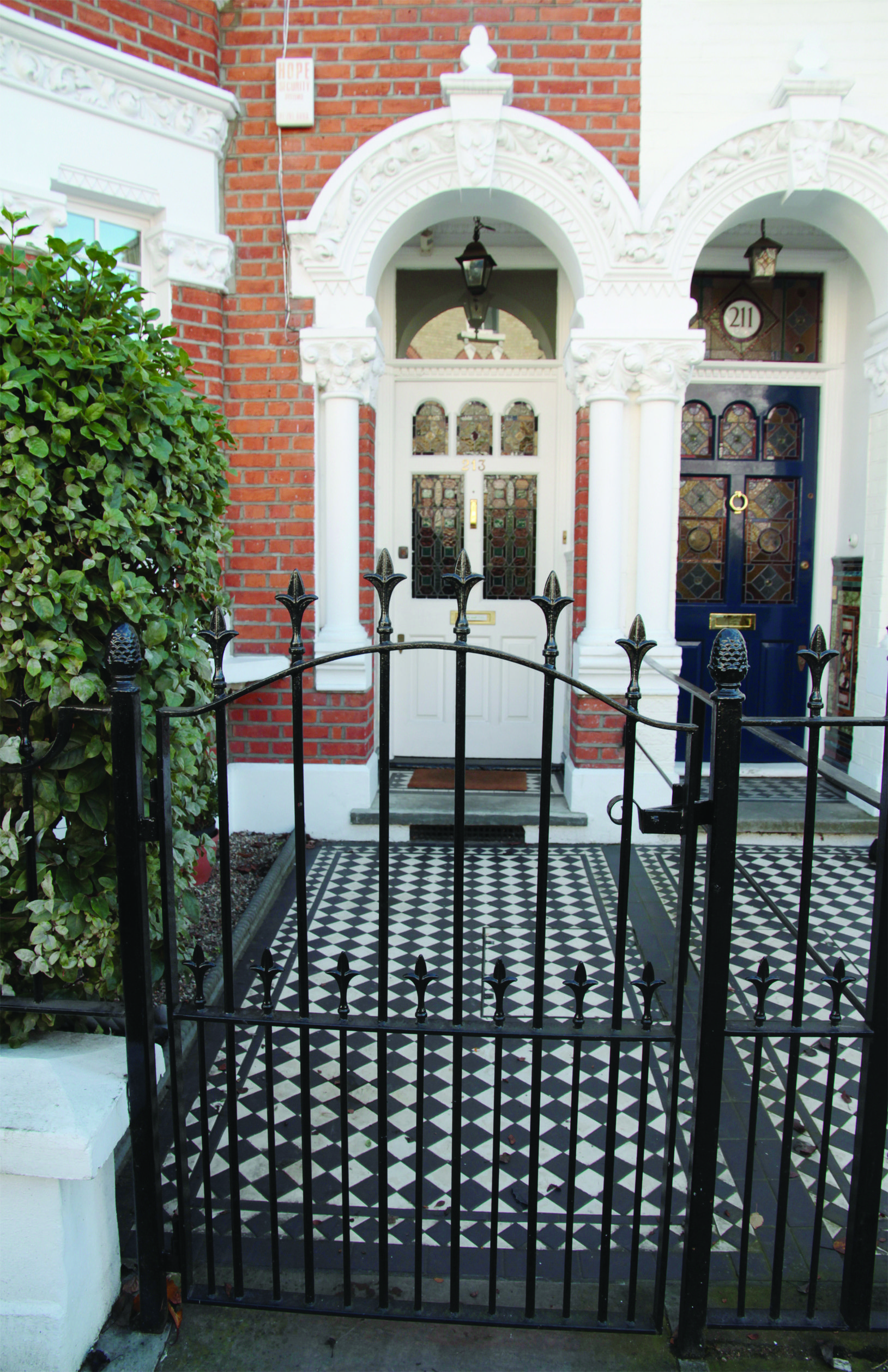 Stylish black cast iron gate outside victorian style home in London ...