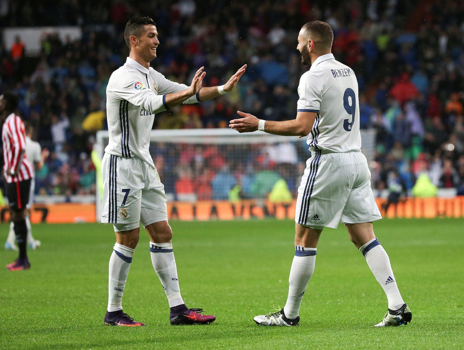 Madrid's Karim Benzema celebrates his goal with teammate Cristiano ...