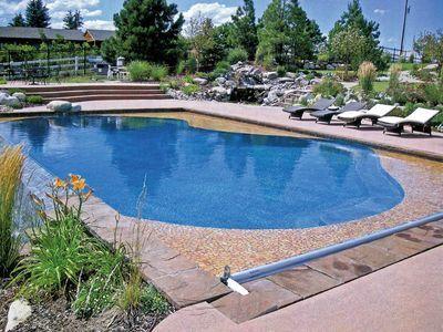 Freeform Pool With Automatic Pool Cover Pool Pool Renovation