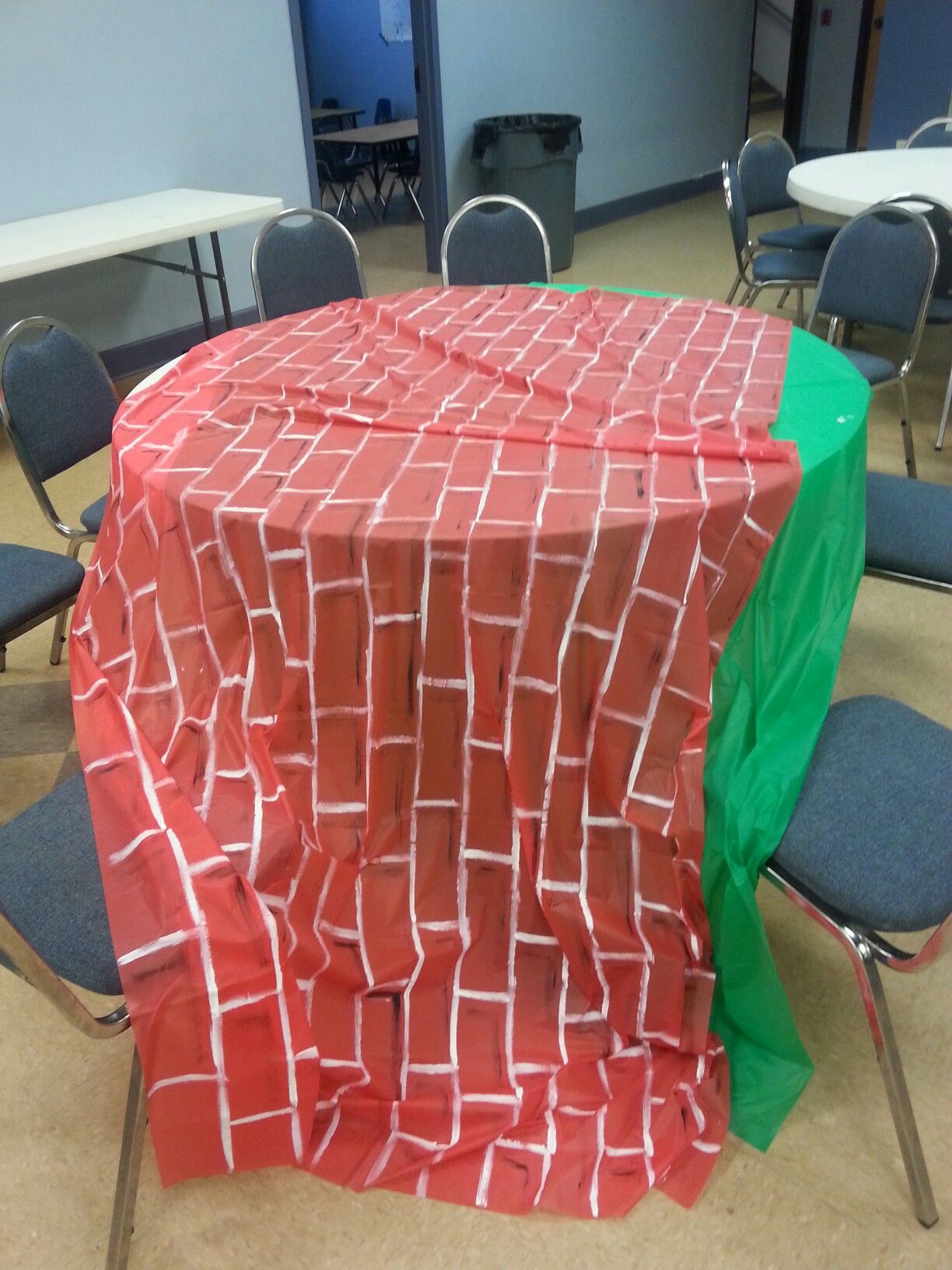 Plastic red tablecloth painted with white acrylic paint for a brick ...