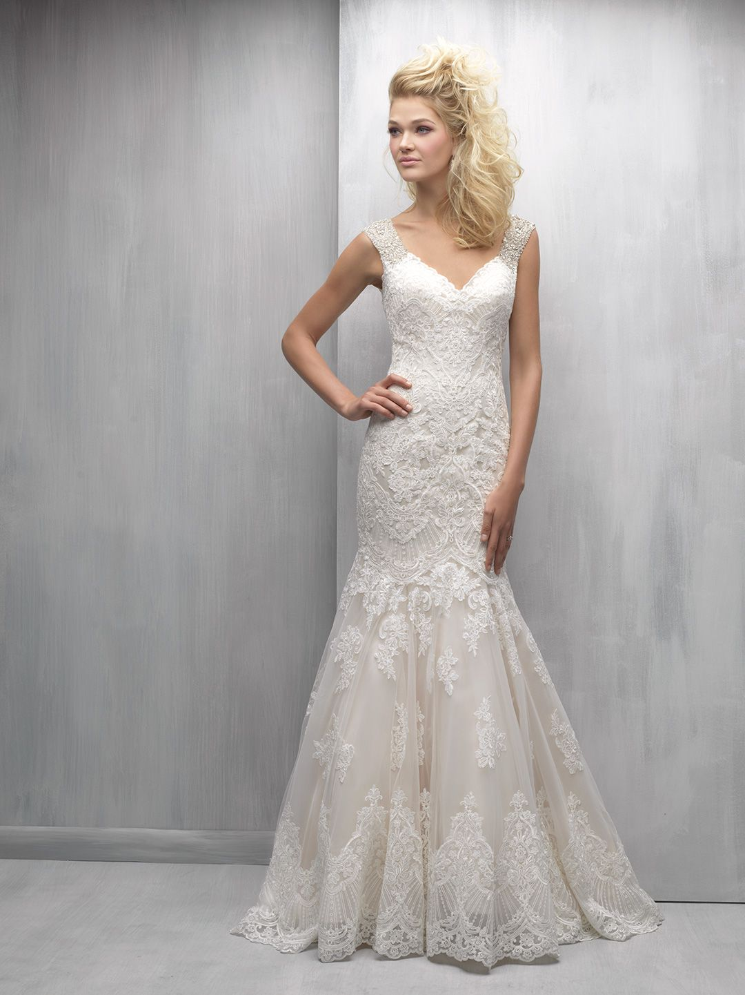 Layers of lace and a crystal beaded cap sleeve add elements of