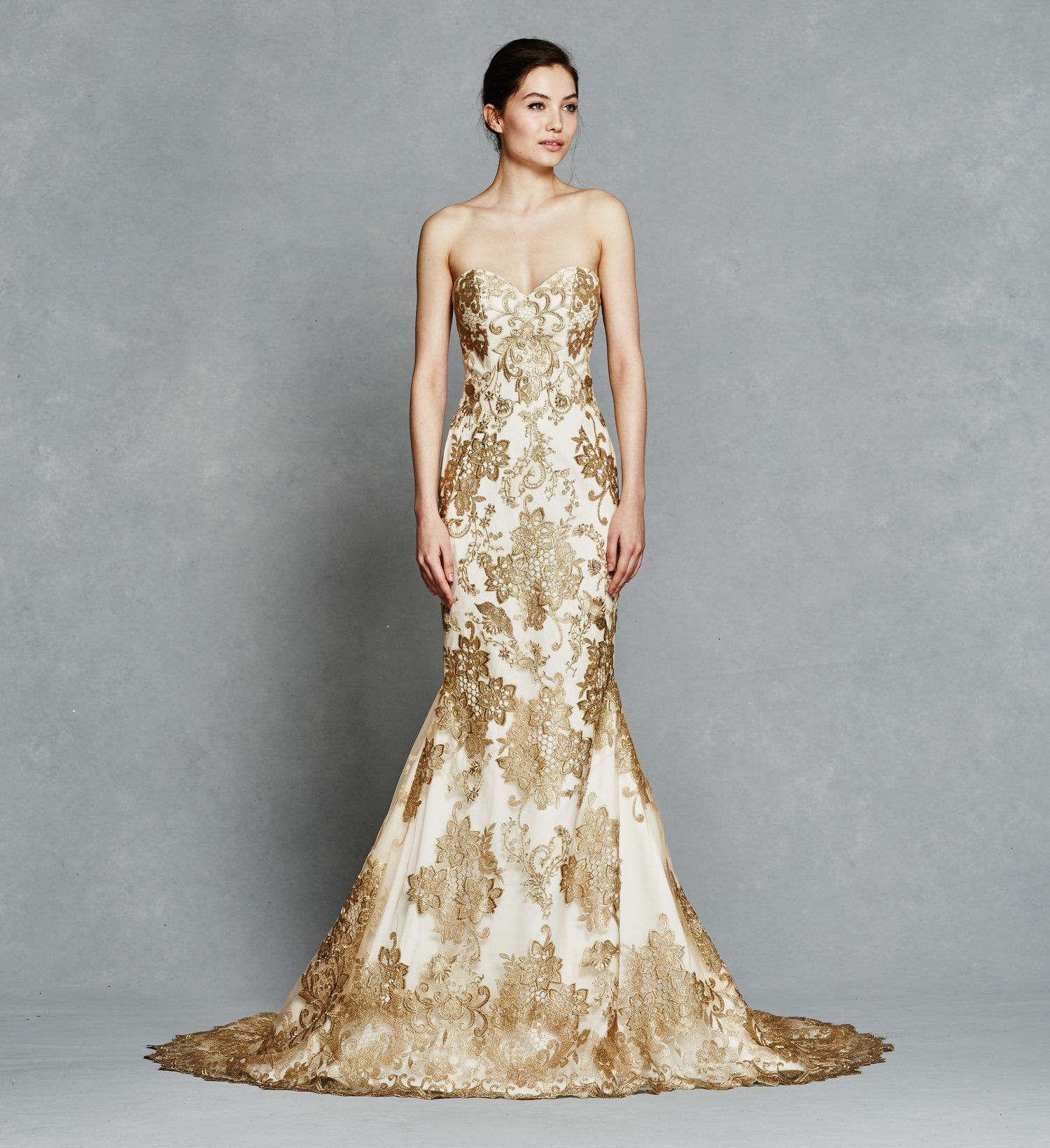 Gold embroidery strapless fit to flare with illusion back neckline and  detachable gold embroidered skirt.  Locate It
