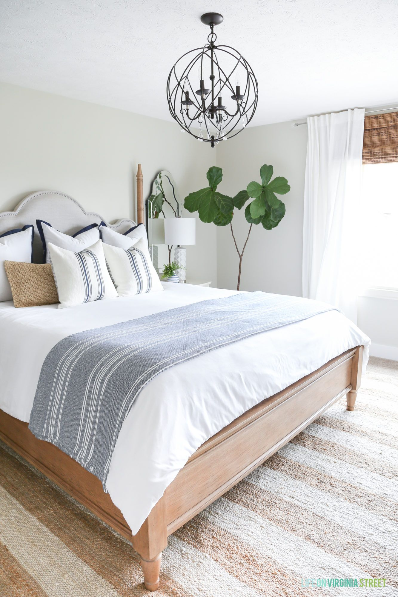 A Coastal Farmhouse Style Bedroom With A Striped Rug, Orb