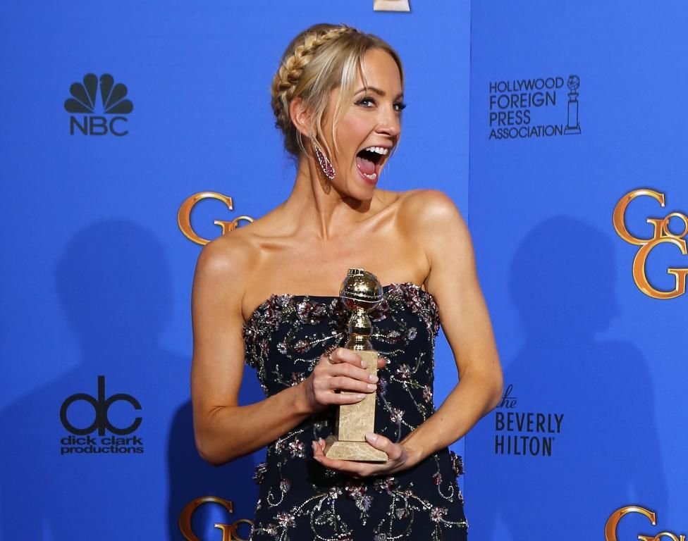 """Joanne Froggatt poses with her award for Best Supporting Actress in a Series, Mini-Series or TV Movie for her role in """"Downton Abbey"""" backstage at the 72nd Golden Globe Awards in Beverly Hills, California January 11, 2015. REUTERS/Mike Blake"""