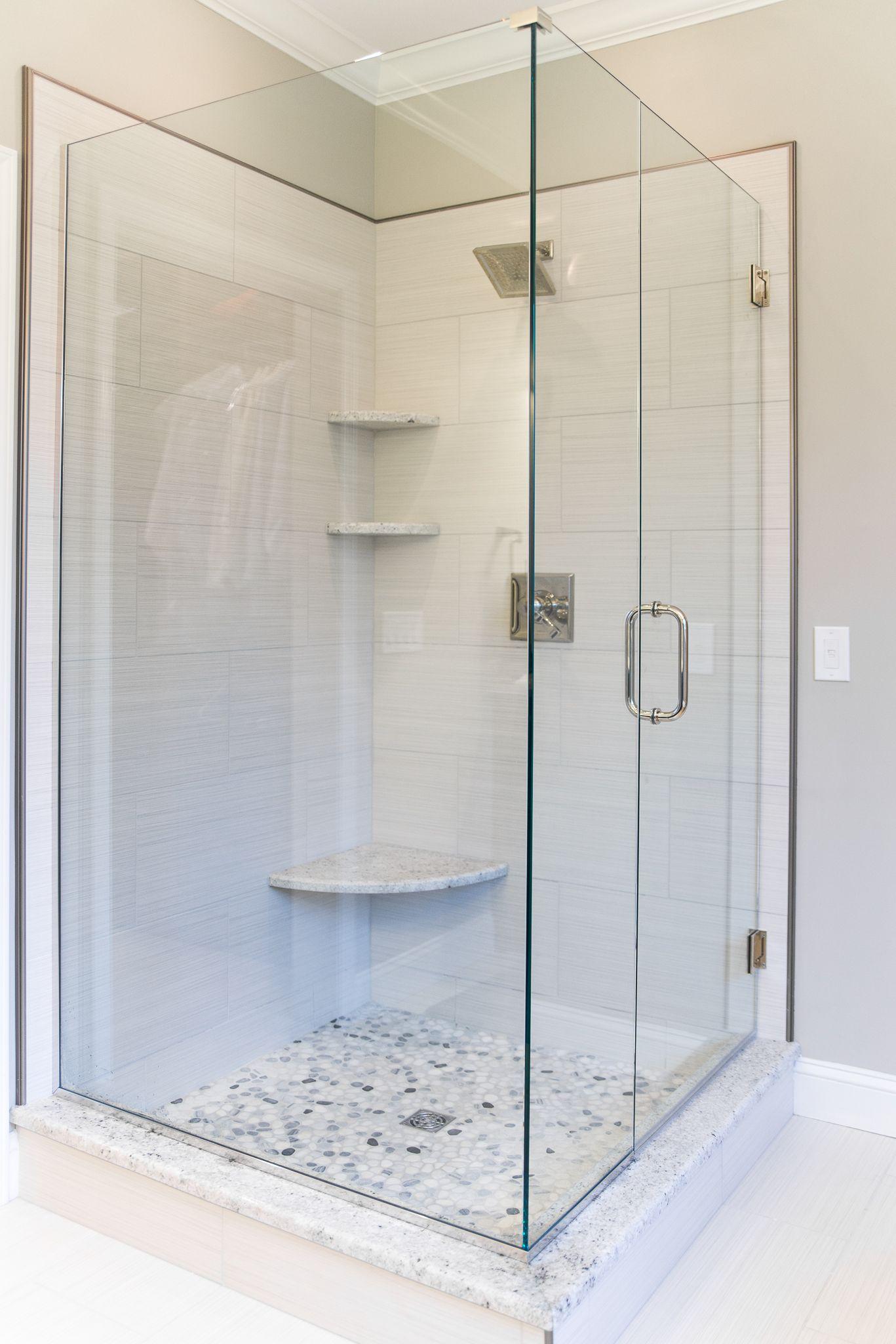 Euro Glass - 12x24 striated porcelain - River rock shower - LZ ...