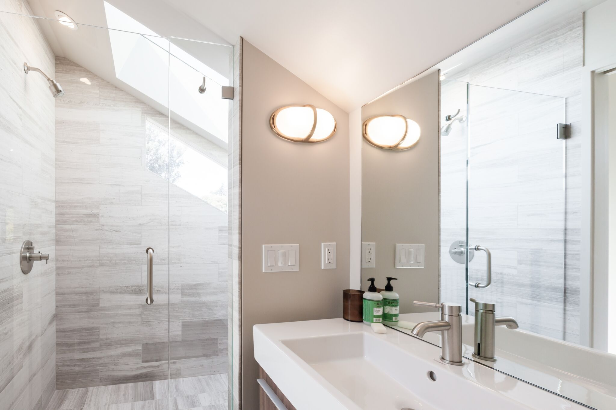 bright bathroom | grey tile | glass shower | contemporary ...