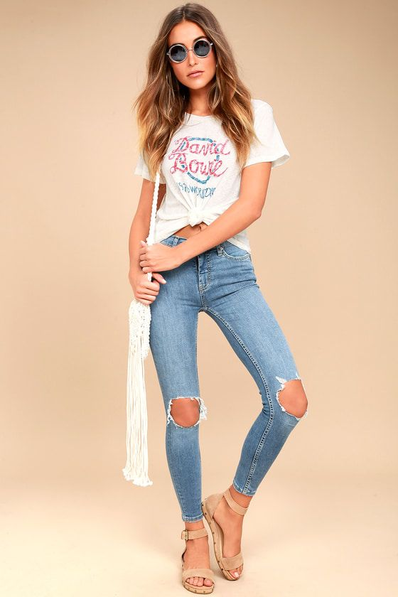 d3eb854e9a8 Go high-waisted or go home! The Free People High Rise Busted Light Wash  Distressed Skinny Jeans have skinny pant legs with distressed knees.