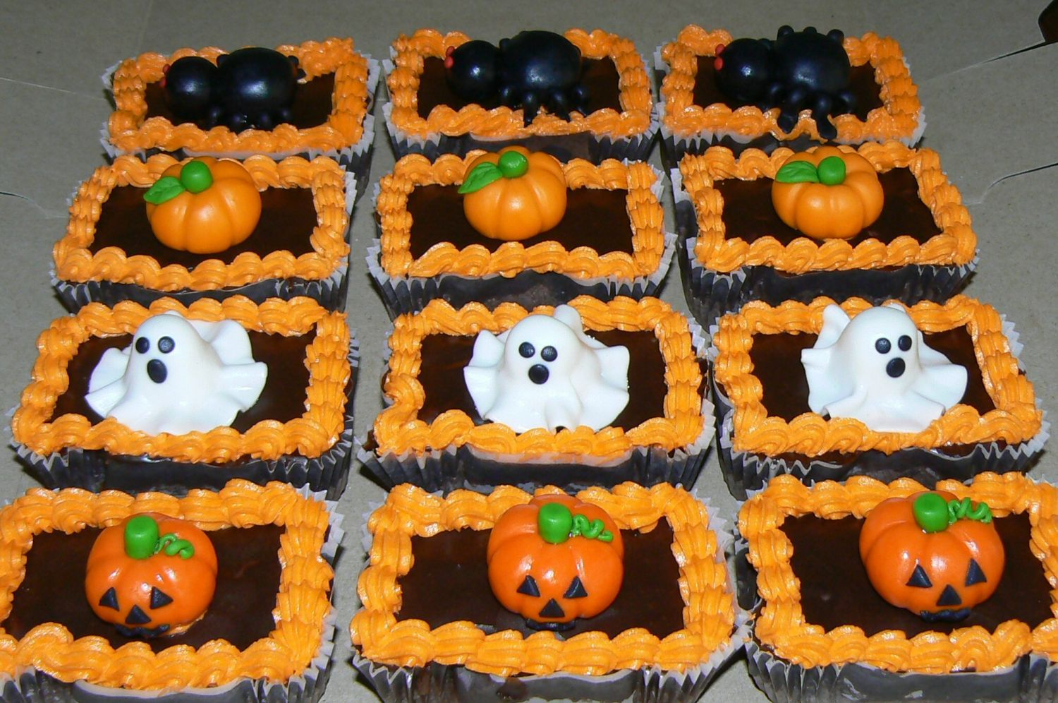 - These are some individual brownies that a customer requested.  They are toped with a chocolate glaze and halloween figures that I made out of fondant.