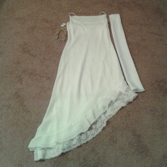 White Out In White Enjoy this white dress that can be used for that special occasion, prom, wedding or a special  function.  The dress has spaghetti straps and lace ruffle on the bottom and it is fully lined. Step in Step out no zipper.  A White accent scarf accompanying this evening dress making it even more elegant. Clean no stains and in excellent condition ready to ship. Aniella Dresses Asymmetrical