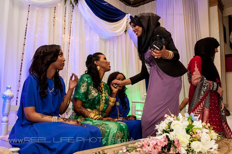Somali bride (in green) and bridesmaids (in blue) in traditional ...