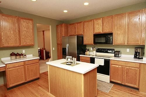 Green paint with oak cabinets