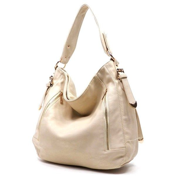 New this week! Handbag with front zippers and side strap details! Limited supply! Hurry in!