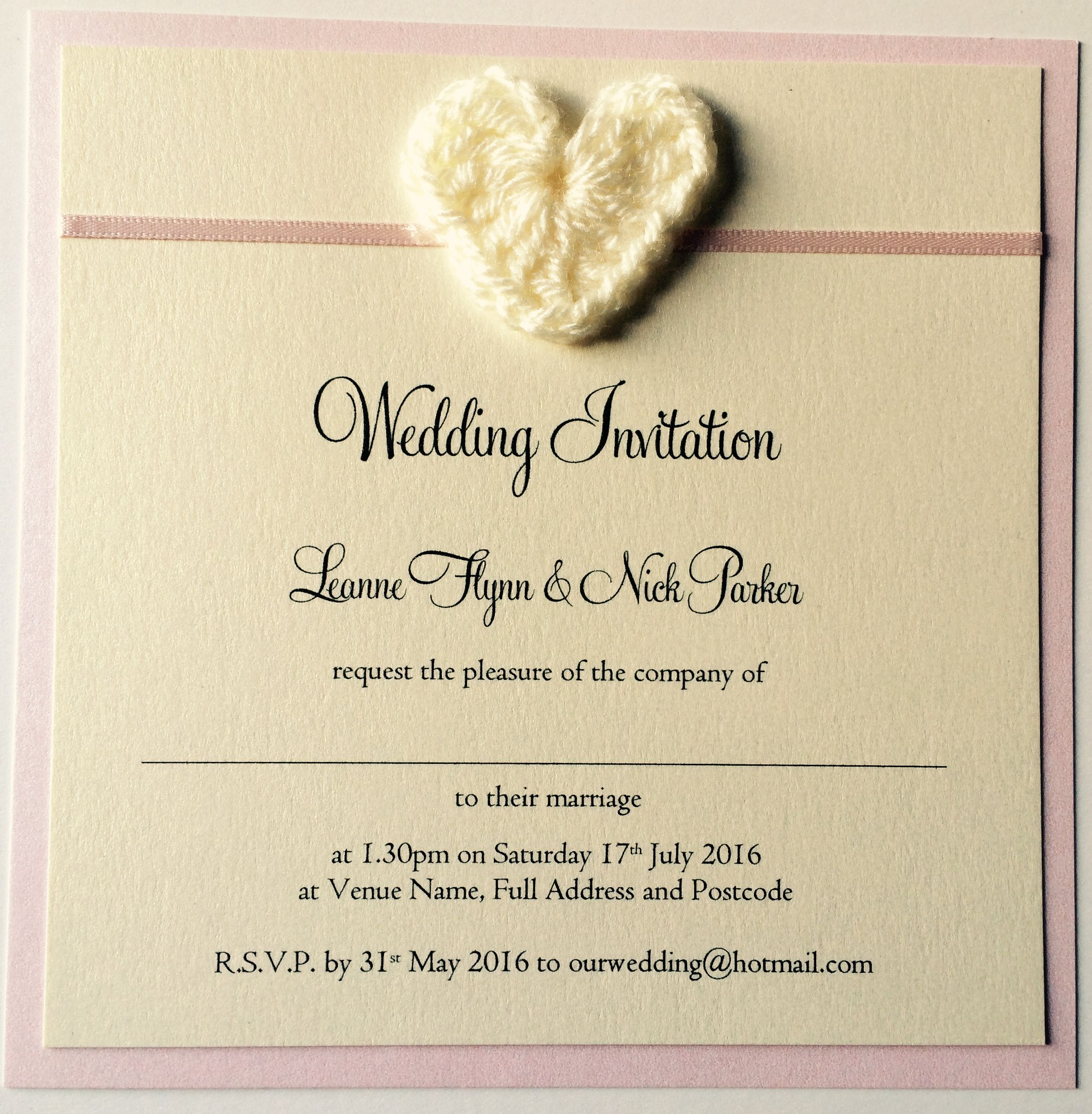 Crochet heart styled wedding invitations with an ivory and baby pink colour scheme