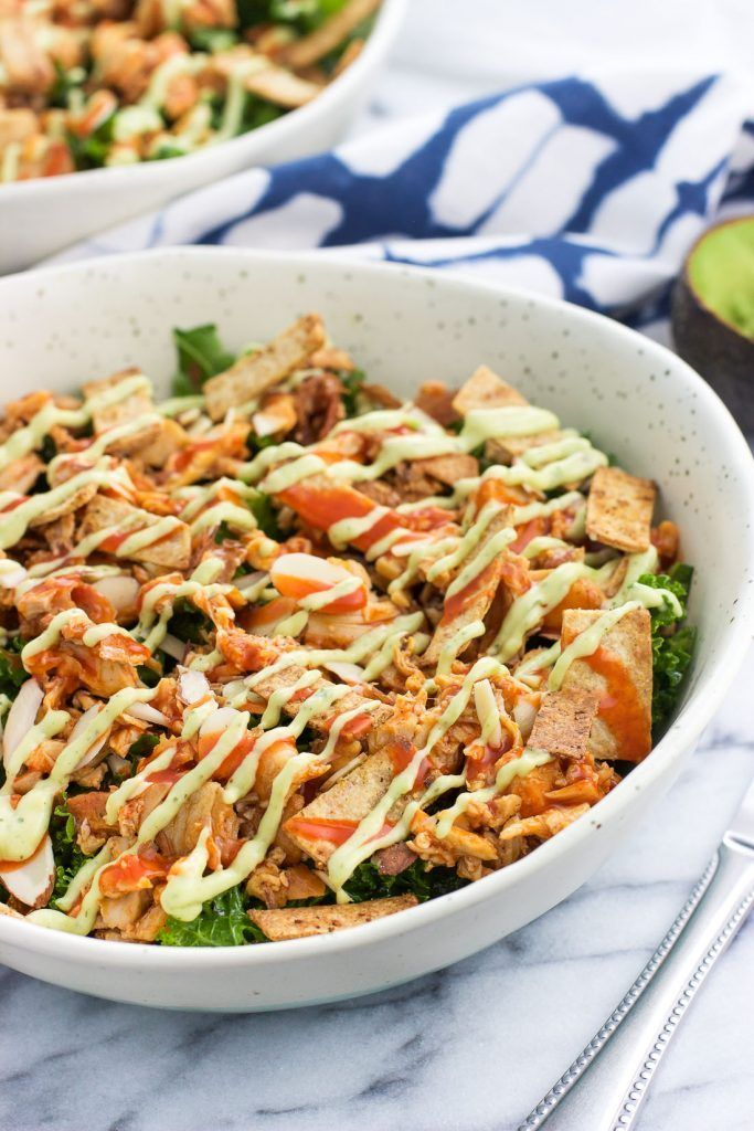 Buffalo chicken kale salad is a filling and healthy lunch or dinner option that makes the most of leftover ingredients. Quickly massaged kale is topped with shredded buffalo chicken, almonds, crispy baked tortilla strips, and a homemade avocado ranch dressing for an ultra flavorful meal. #avocadoranch Buffalo chicken kale salad is a filling and healthy lunch or dinner option that makes the most of leftover ingredients. Quickly massaged kale is topped with shredded buffalo chicken, almonds, crisp #avocadoranch