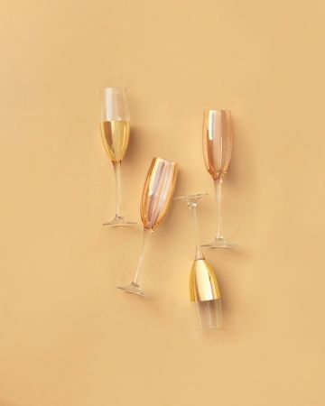 These gold-and-rose champagne flutes have celebration written all over them