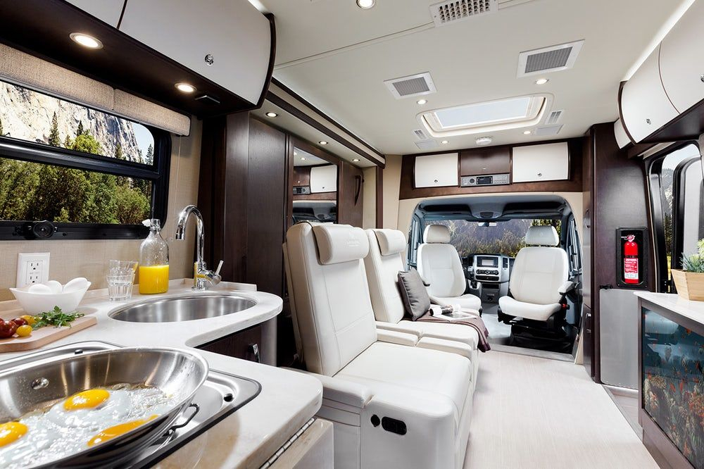 Unity motorhome combines Murphy bed and swivel recliners