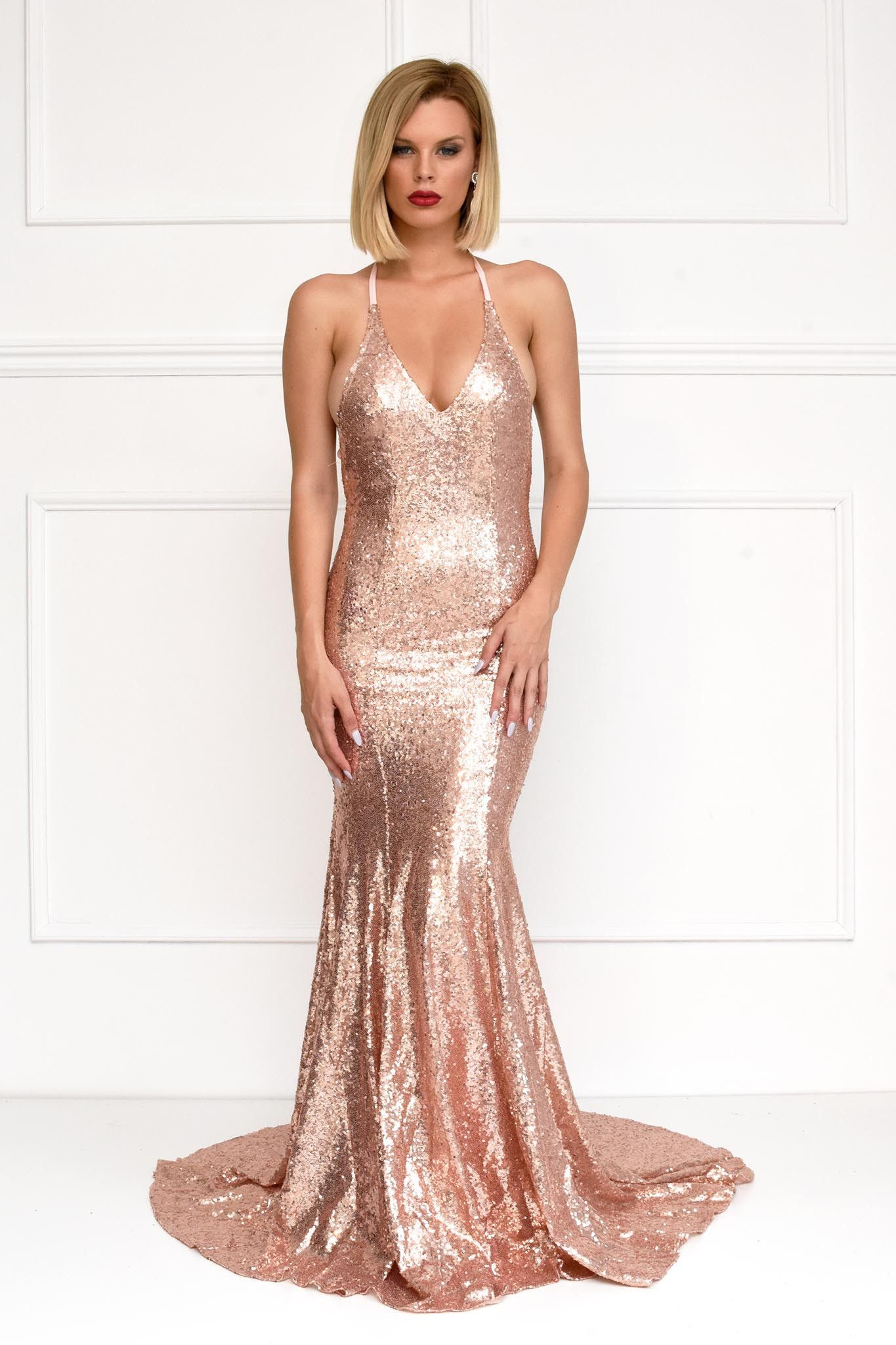 8814476e Front of rose gold sequin formal floor-length evening gown lowcut deep v  neck spaghetti straps