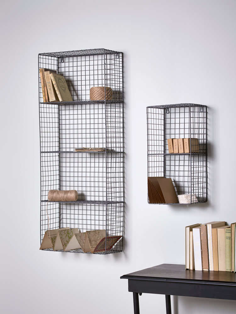 Stylish and practical, our wire wall rack has two shelves and handy  keyholes to
