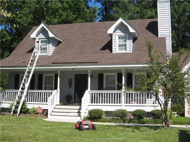 Black Shutters Brown Roof Exterior Paint Colors For House Brown Roofs House Paint Exterior