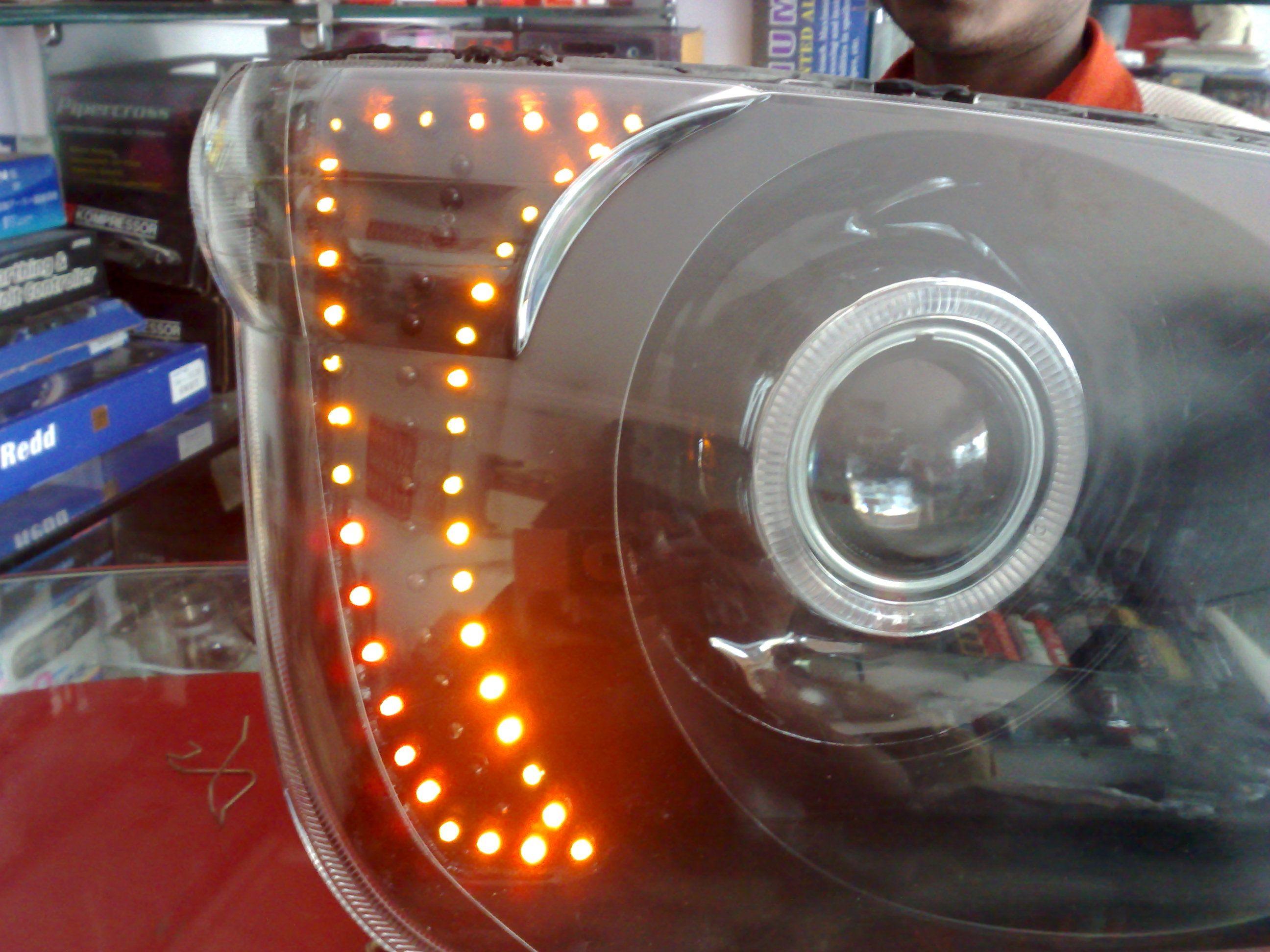 Mahindra bolero customised projector headlights with projector angel eye and leds