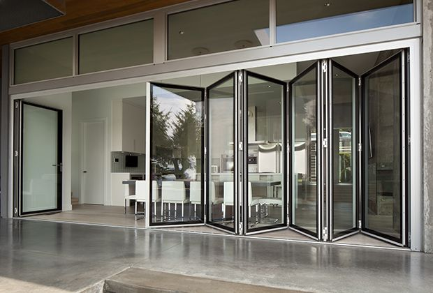 Folding glass walls eight systems of connected bi fold for Retractable walls commercial