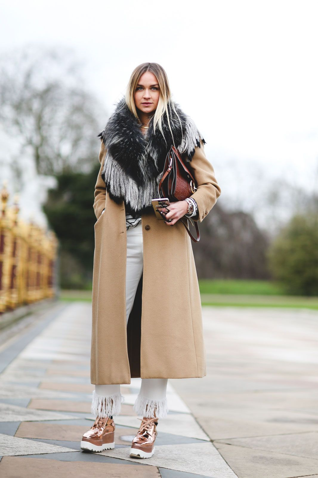 London Street Style That Just Oozes Cool #refinery29  http://www.refinery29.com/2016/02/103453/london-fashion-week-fall-winter-2016-street-style-pictures#slide-44  Platformed sneakers bring us back to our Spice Girls days (and we couldn't be happier)....